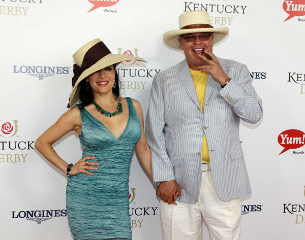 Comedian Ron White arrives with singer Margo Rey for the 138th Kentucky Derby horse race at Churchill Downs Saturday, May 5, 2012, in Louisville, Ky.  <span class=meta>(AP Photo&#47; Darron Cummings)</span>