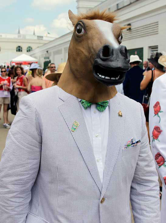 Gino Desimone arrives in a horse head mask for the 138th Kentucky Derby horse race at Churchill Downs Saturday, May 5, 2012, in Louisville, Ky. <span class=meta>(AP Photo&#47; Darron Cummings)</span>