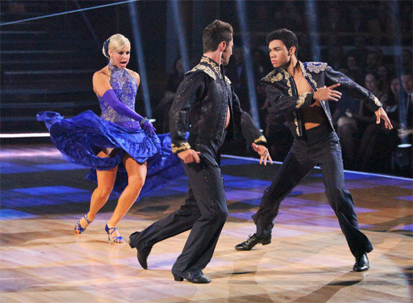 "<div class=""meta ""><span class=""caption-text "">Disney Channel star Roshon Fegan and his partner Chelsie Hightower, along with guest dancer Sasha Farber, received 27 out of 30 points from the judges for their 'Trio' Paso Doble on week eight of 'Dancing With The Stars,' which aired on Monday, May 7, 2012. His total score was 56 out of 60 points. (ABC Photo/ Adam Taylor)</span></div>"