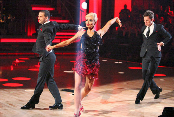 "<div class=""meta image-caption""><div class=""origin-logo origin-image ""><span></span></div><span class=""caption-text"">Classical singer Katherine Jenkins and her partner Mark Ballas, along with guest dancer Tristan MacManus, received 29 out of 30 points from the judges for their 'Trio' Cha Cha Cha on week eight of 'Dancing With The Stars,' which aired on Monday, May 7, 2012. Her total score was 55 out of 60 points. (ABC Photo/ Adam Taylor)</span></div>"