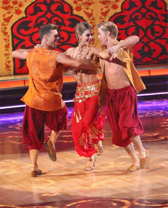 TV personality Maria Menounos and her partner Derek Hough, along with guest dancer Henry Byalikov, received 25 out of 30 points from the judges for their &#39;Trio&#39; Samba on week eight of &#39;Dancing With The Stars,&#39; which aired on Monday, May 7, 2012. Her total score was 53 out of 60 points. <span class=meta>(ABC Photo&#47; Adam Taylor)</span>
