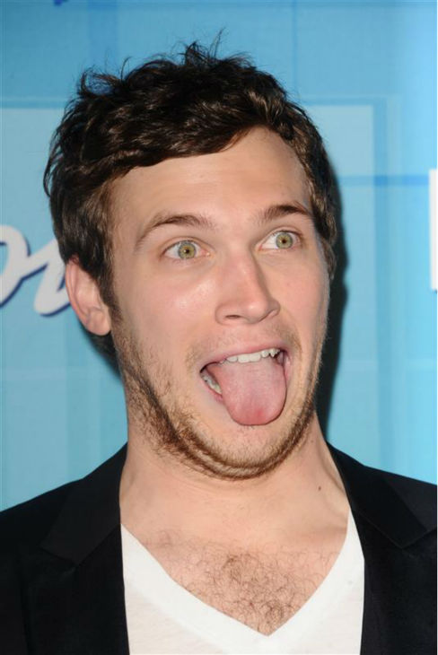"<div class=""meta ""><span class=""caption-text "">Phillip Phillips has fun with the photographers backstage at the 'American Idol' season 11 finale after winning the competition on May 23, 2012.  (Sara De Boer / Startraksphoto.com)</span></div>"
