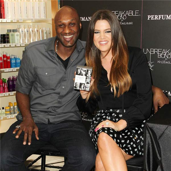 Khloe Kardashian and Lamar Odom appear at an event in Orange County, California, for their perfume 'Unbreakable Bond' on June 7, 2012.