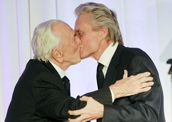 Actor Michael Douglas, right, introduces his...