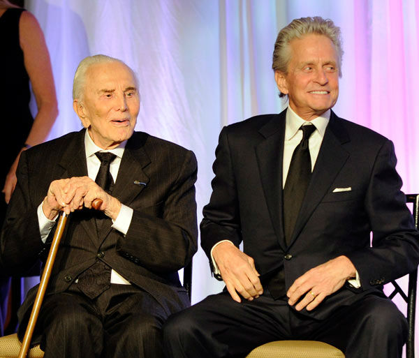 Actor Michael Douglas, right, introduces his father, honoree Kirk Douglas at the 'Children At Hope' gala dinner at Pier Sixty on Monday, Nov. 21, 2011 in New York.
