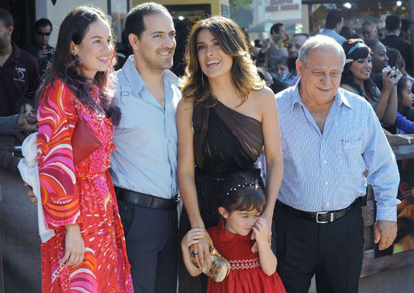 Salma Hayak, at center, her daughter Valentina Pinault, brother Sami Hayak, at left, Daniela Villegas, far left, and Salma Hayak's father, Sami Hayak Dominguez, at right,  arrive at the premiere of 'Puss In Boots,' Sunday, Oct. 22, 2011, at The Regency Vi