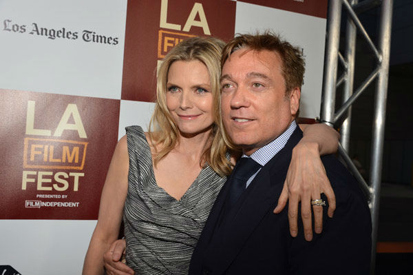 Actress Michelle Pfeiffer and CAA's Kevin Huvane attend the 2012 Los Angeles Film Festival Premiere of 'People Like Us' at Regal Cinemas L.A. LIVE Stadium 14 on June 15, 2012 in Los Angeles, California.