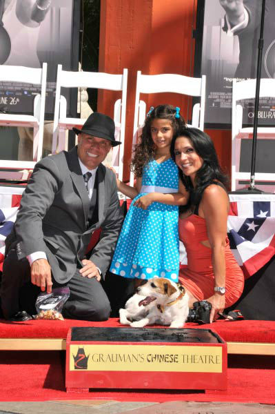 Uggie, the 10-year-old Jack Russell terrier who starred in &#39;The Artist,&#39; was honored with a retirement party and a paw print ceremony at Grauman&#39;s Chinese Theatre on June 25, 2012. Uggie is seen with his trainer, Omar Von Muller, and family at the event.  &#39;The Artist&#39; will be released on Blu-ray and DVD on June 26. <span class=meta>(Photo&#47;Robert Freeman)</span>