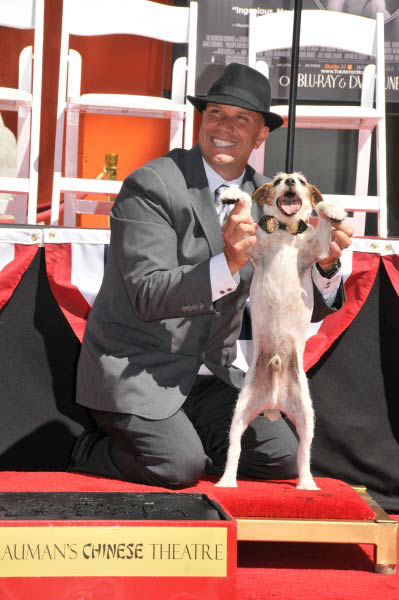 Uggie, the 10-year-old Jack Russell terrier who starred in &#39;The Artist,&#39; was honored with a retirement party and a paw print ceremony at Grauman&#39;s Chinese Theatre on June 25, 2012. Uggie is seen with his trainer Omar Von Muller at the event.  &#39;The Artist&#39; will be released on Blu-ray and DVD on June 26. <span class=meta>(Photo&#47;Robert Freeman)</span>