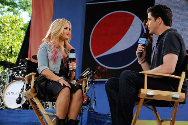 Demi Lovato talks to Josh Elliot during her live performance from Central Park in New York City on &#39;Good Morning America,&#39; on July 6, 2012, airing on the ABC Television Network. <span class=meta>(ABC Photo&#47; Donna Svennevik)</span>