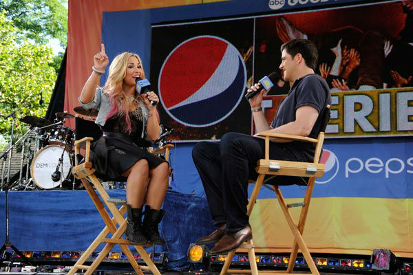 "<div class=""meta ""><span class=""caption-text "">Demi Lovato talks to Josh Elliot during her live performance from Central Park in New York City on 'Good Morning America,' on July 6, 2012, airing on the ABC Television Network. (ABC Photo/ Donna Svennevik)</span></div>"