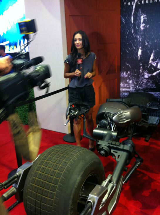 OnTheRedCarpet.com host Rachel Smith appears in a photo with the Batpod from 'The Dark Knight Rises' at San Diego Comic-Con on Wednesday, July 11, 2012.