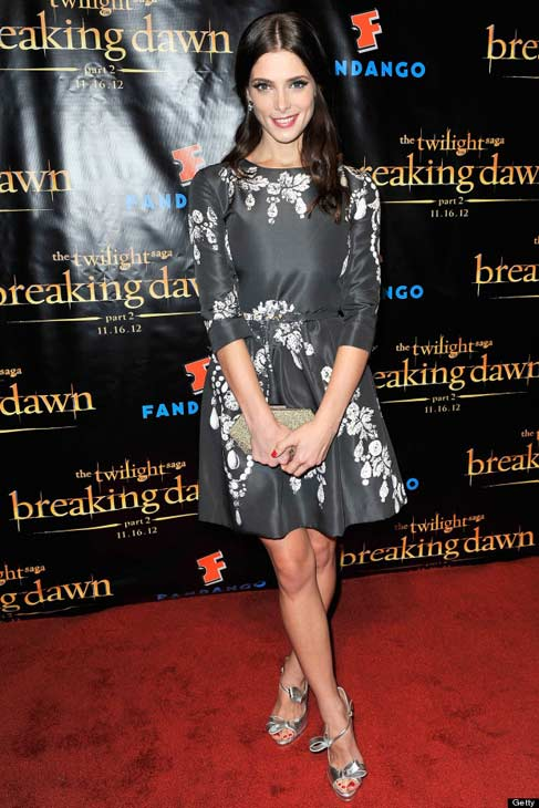 Ashley Greene wore Oscar de la Renta to &#39;The Twilight Saga: Breaking Dawn Part 2&#39; Comic-Con Celebration on July 11, 2012 in San Diego, CA.  The full look, including the bijoux printed silk faille dress, the gold sequin Cara vanity case, and the silver nappa bow pump, are all from the designer&#39;s Fall 2012 collection. <span class=meta>(Photo courtesy of Getty)</span>