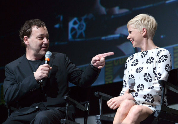 Director Sam Raimi and Michelle Williams of &#39;Oz: the Great and Powerful,&#39; appear in a photo at San Diego Comic-Con on Thursday, July 12, 2012.  <span class=meta>(WireImage Photo&#47;Alberto E. Rodriguez)</span>