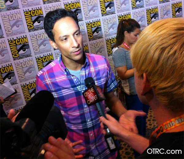 "<div class=""meta image-caption""><div class=""origin-logo origin-image ""><span></span></div><span class=""caption-text"">Danny Pudi of 'Community' appears in a photo at San Diego Comic-Con on Friday, July 13, 2012. (OTRC Photo)</span></div>"