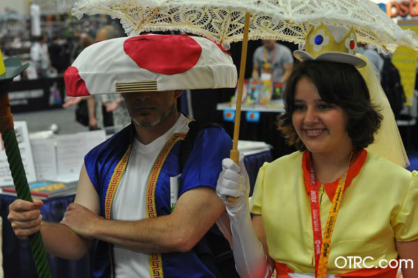 Fans dressed as Toad and Princess Daisy from...