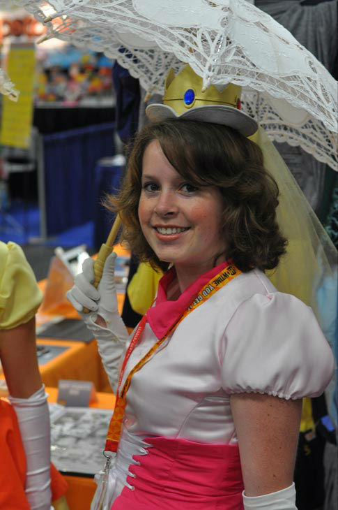A fan dressed as Princess Peach from 'Super...
