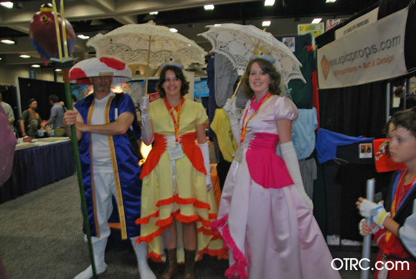 Fans dressed as Toad, Princess Daisy and...