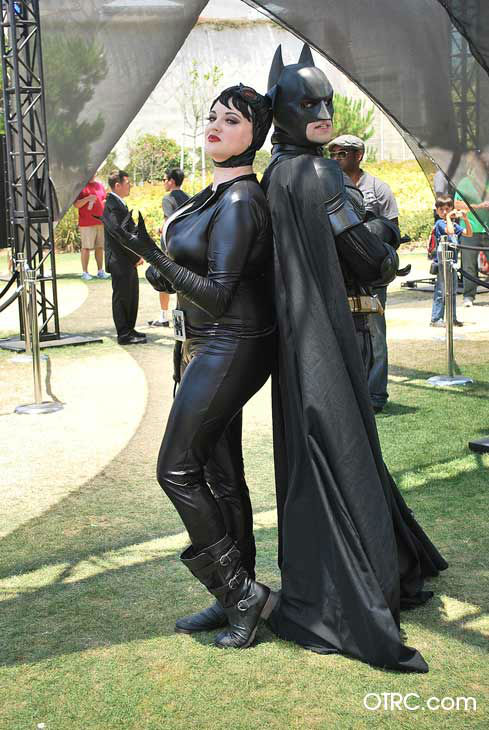 Fans dressed as Catwoman and Batman appear in a...
