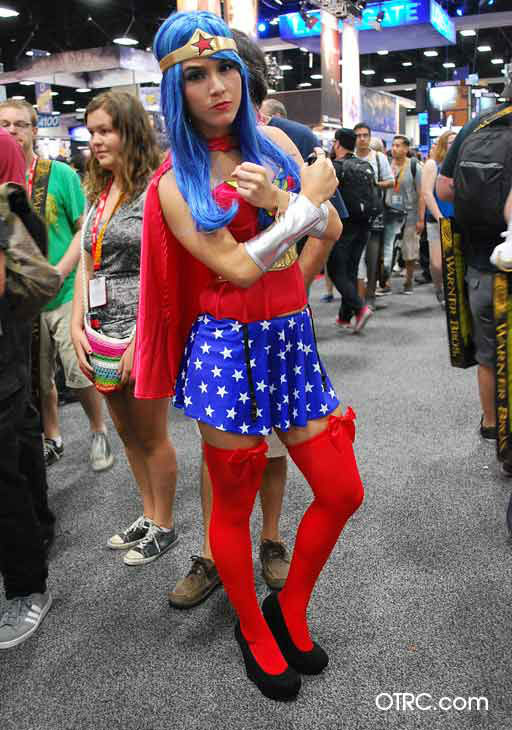 A fan dressed as Wonderwoman appears in a photo...