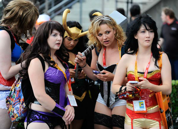 "<div class=""meta ""><span class=""caption-text "">Fans dressed in costumes do a little people watching on the second day of Comic-Con convention held at the San Diego Convention Center on Friday July 13, 2012, in San Diego.  (AP Photo/ Denis Poroy)</span></div>"