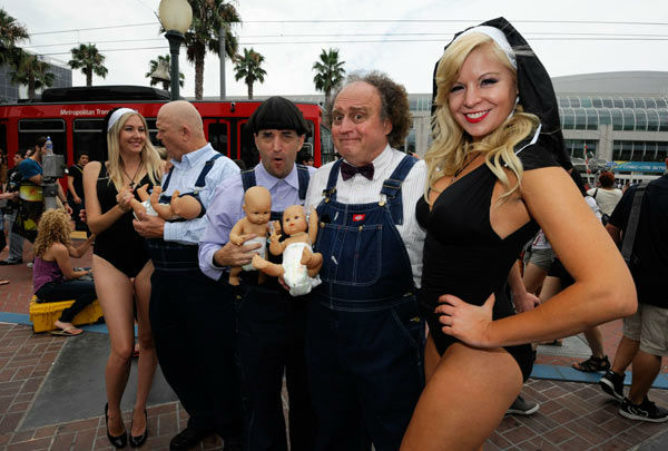 Actors promoting a Three Stooges movie gesture to fans  on the second day of Comic-Con convention held at the San Diego Convention Center on Friday July 13, 2012, in San Diego. <span class=meta>(AP Photo&#47; Denis Poroy)</span>