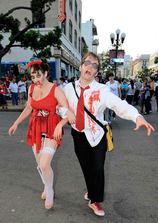 "<div class=""meta ""><span class=""caption-text "">Undead walk in the Zombie Walk on the second day of Comic-Con convention held at the San Diego Convention Center on Friday July 13, 2012, in San Diego.   (AP Photo/ Denis Poroy)</span></div>"