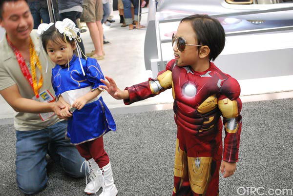 A young fan dressed as Iron Man and one dressed...