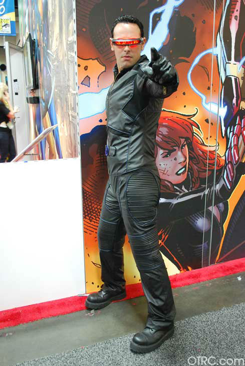 A fan dressed as Cyclops of 'X-Men' appears in a...