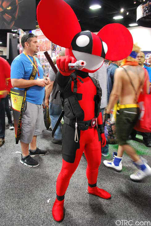 A fan dressed as a mix of the comic book character Deadpool and the electronic dance music producer deadmau5 appears in a photo at San Diego Comic-Con on Sunday, July 15, 2012.