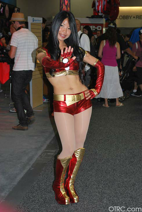 A fan dressed as a female Iron Man appears in a...