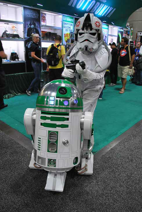 An R2 unit and a fan dressed as a 'Star Wars' character appear in a photo at San Diego Comic-Con on Sunday, July 15, 2012.