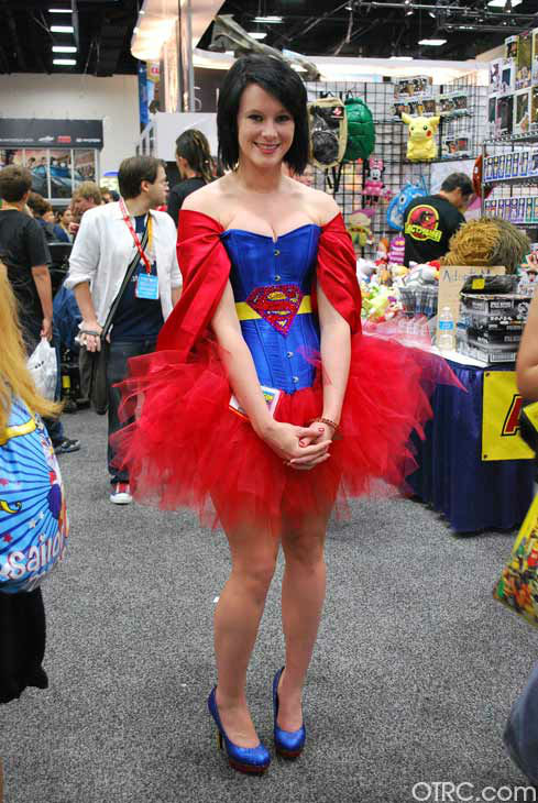 A fan dressed as Supergirl appears in a photo at...