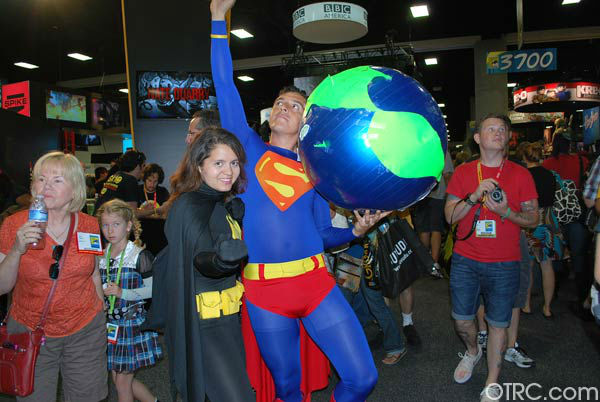 A fan dressed as Superman appears in a photo at...
