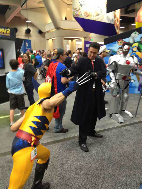 A fan dressed as Wolverine appears in a photo at...