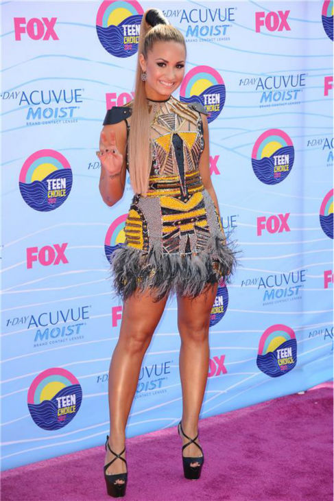 "<div class=""meta image-caption""><div class=""origin-logo origin-image ""><span></span></div><span class=""caption-text"">Demi Lovato walks the pink carpet at the 2012 Teen Choice Awards at the Gibson Amphitheatre in in Universal City, California on July 22, 2012. (Kyle Rover / Startraksphoto.com)</span></div>"
