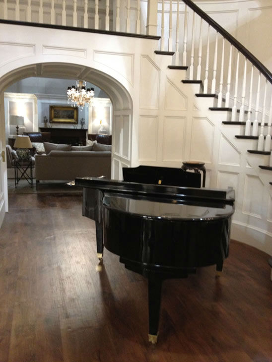 Pictured is a winding staircase and piano inside...
