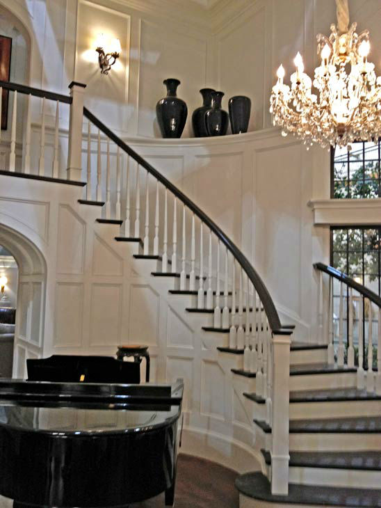 Pictured is a winding staircase and piano inside Grayson Manor from the set of the ABC drama series &#39;Revenge.&#39; The photo was taken on July 26, 2012, during a set visit by members of the Television Critics Association. Season 2 premieres on September 30 at a new time slot - moving from Wednesdays to Sundays at 9 p.m.  <span class=meta>(OTRC &#47; ABC)</span>