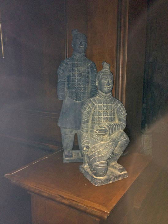 Pictured are decorative statues inside of...