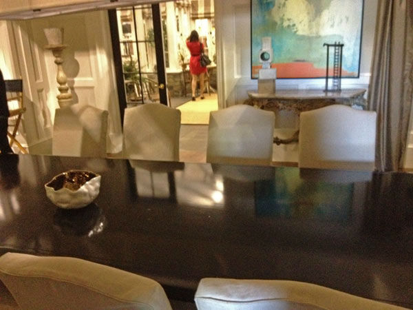 Pictured is a dining room table inside of...