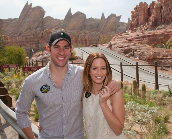 Actors Emily Blunt and John Krasinski pose at the all-new Cars Land in Disney California Adventure park in Anaheim, Calif., on Friday, July 27, 2012.
