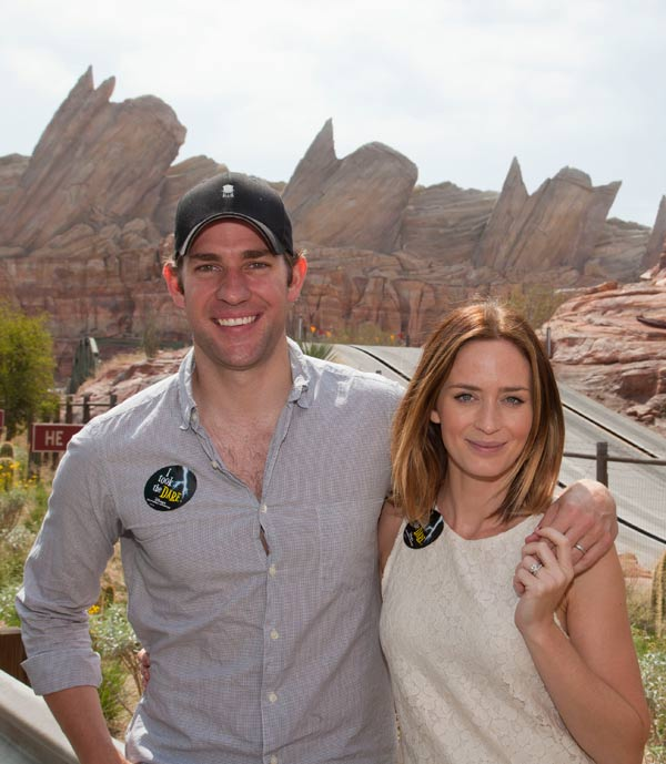Actors Emily Blunt and John Krasinski pose at...