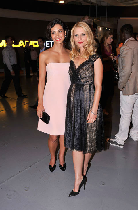 Actresses Morena Baccarin and Claire Danes attend the Showtime and Time Warner Cable hosted premiere screening and reception to launch the second season of 'Homeland' at the Intrepid Sea-Air-Space Museum on September 7, 2012 in New York City.