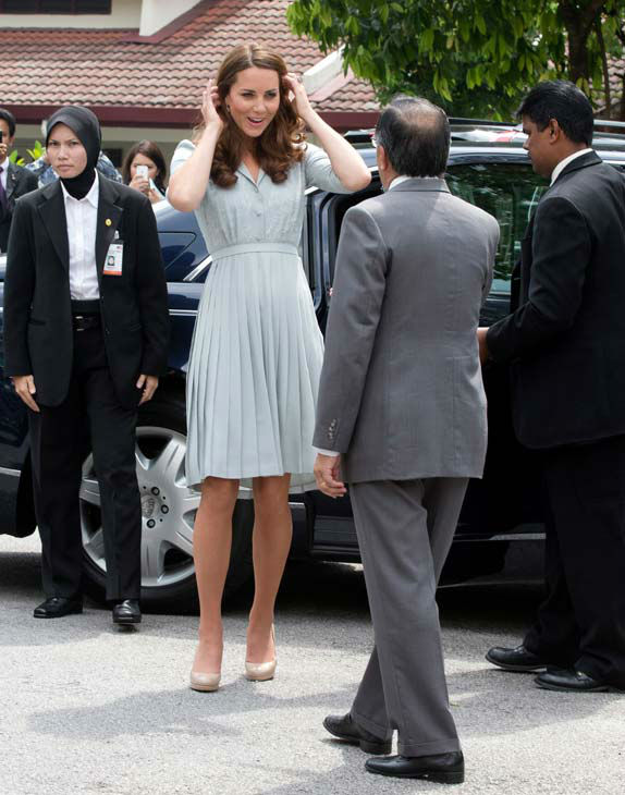 Britain&#39;s Kate, the Duchess of Cambridge is greeted by Brig. Gen. Richard Robless on her arrival at Hospis Malaysia in Kuala Lumpur, Malaysia, Thursday, Sept. 13, 2012.  Prince William and Kate are in Malaysia for a three-day visit as part of a tour to mark Queen Elizabeth II&#39;s Diamond Jubilee. Middleton wore a Jenny Packham bespoke eucalyptus silk crepe shirt dress with a French lace bodice. <span class=meta>(AP Photo&#47; Mark Baker)</span>