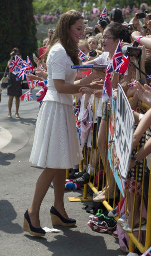 "<div class=""meta ""><span class=""caption-text "">The Duke and Duchess of Cambridge visit the botanic gardens in Singapore on September 12, 2012, on behalf of The Queen in celebration of Her Majesty's Diamond Jubilee. Middleton wore a white eyelet skirt suit designed by Alexander McQueen with navy blue Stuart Weizman Corkswoon wedges. (Ian Vogler / The Daily Mirror)</span></div>"