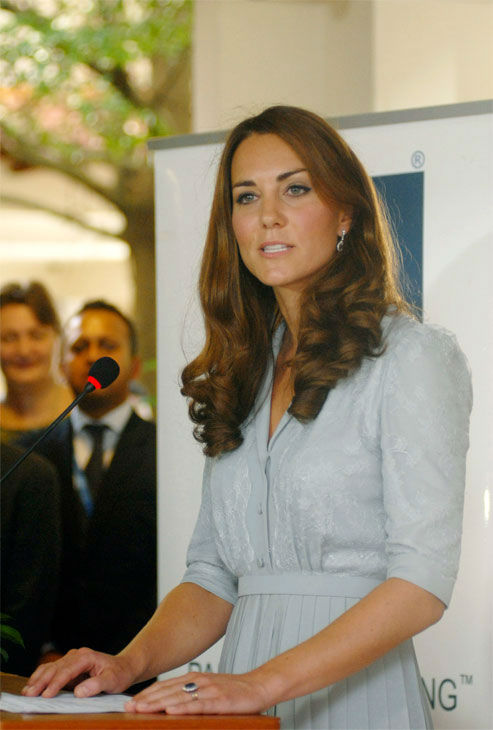 In this photo released by Malaysia&#39;s Information Department, Britain&#39;s Kate, the Duchess of Cambridge, delivers a speech at Hospis Malaysia in Kuala Lumpur, Malaysia, Thursday, Sept. 13, 2012. Britain&#39;s Prince William and his wife Kate, the Duke and Duchess of Cambridge, are in Malaysia for a three-day visit as part of a tour to mark Queen Elizabeth II&#39;s Diamond Jubilee. Middleton wore a Jenny Packham bespoke eucalyptus silk crepe shirt dress with a French lace bodice. <span class=meta>(AP Photo&#47; Uncredited)</span>