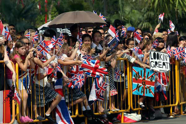 Well wishers wait to see Prince William Duke of Cambridge and his wife Catherine Duchess of Cambridge tour Gardens by the Bay in Singapore, Wednesday, Sept. 12, 2012. The Duke and Duchess are on their first stop of a 10 day tour of Southeast Asia and the South Pacific on behalf of Queen Elizabeth II to commemorate her Diamond Jubilee. <span class=meta>(AP Photo&#47; STEPHEN MORRISON&#47;POOL)</span>