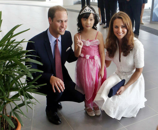"<div class=""meta ""><span class=""caption-text "">The Duke and Duchess of Cambridge visit the botanic gardens in Singapore on September 12, 2012, on behalf of The Queen in celebration of Her Majesty's Diamond Jubilee. Middleton wore a white eyelet skirt suit designed by Alexander McQueen with navy blue Stuart Weizman Corkswoon wedges. (Danny Lawson)</span></div>"
