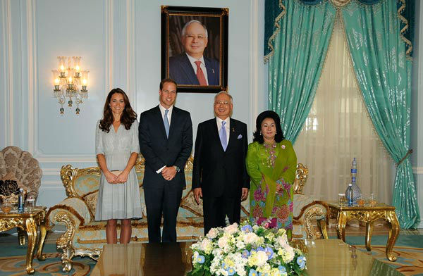 In this photo released by Malaysia&#39;s Information Department, Britain&#39;s Prince William, second from left, and his wife Kate, left, the Duke and Duchess of Cambridge, pose with Malaysian Prime Minister Najib Razak, second from right, and his wife Rosmah Mansor during a luncheon in Putrajaya, Malaysia, Thursday, Sept. 13, 2012. The royal couple are in Malaysia for a three-day visit as part of a tour to mark Queen Elizabeth II&#39;s Diamond Jubilee. Middleton wore a Jenny Packham bespoke eucalyptus silk crepe shirt dress with a French lace bodice. <span class=meta>(AP Photo&#47; Uncredited)</span>