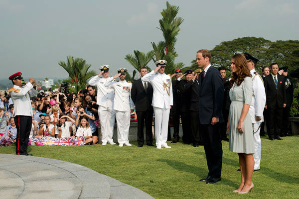 Britain&#39;s Prince William and his wife Kate, the Duke and Duchess of Cambridge, stand together to pay their respects to the war dead of World War II during a visit to the Kranji War Memorial in Singapore Thursday, Sept. 13, 2012. Middleton wore a Jenny Packham bespoke eucalyptus silk crepe shirt dress with a French lace bodice. <span class=meta>(AP Photo&#47; Nicolas Asfouri)</span>